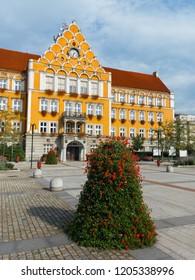Mestsky urad / Urzad miejski ( Town hall ), Cesky Tesin / Czeski Cieszyn, Silesia, Czech Republic, Central Europe - square and orange building of municipality made in neo-renaissance style - Shutterstock ID 1205338996