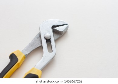 metal adjustable wrench on white background
