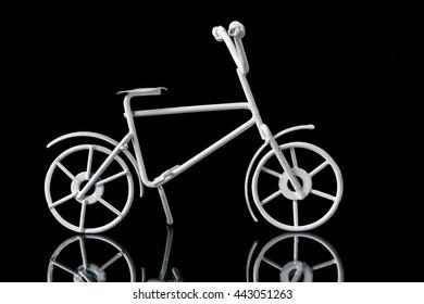"metal artifact ""bicycle"" on a black background."