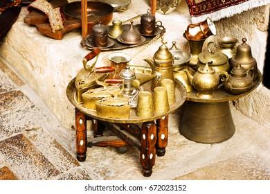 Metal authentic dishware at turkish bazaar, coffee set