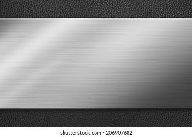 Metal background on black leather