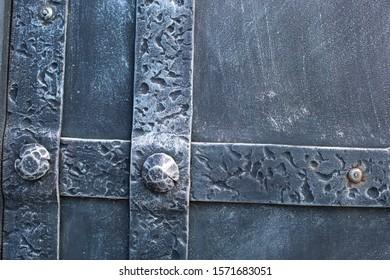 Metal background, riveted metal plate. Industrial metal plate background with few rivets