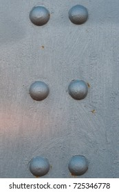 metal background with rivets and arches