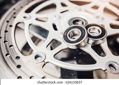 Metal ball bearing on motorcycle disk brake. Motorbike repair