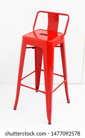 Metal bar chair isolated on white background. Strong tall bar stools in different colors. Bar stool with cushion seating.