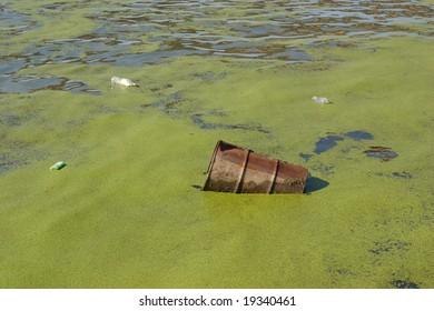 Metal barrel floating in river #2