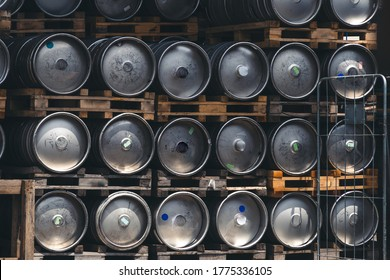Metal barrel. Keg with beer. A large number. Stock. Logistics and alcohol concept. Wooden pallets.
