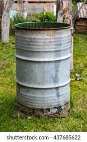 Metal barrel on grass