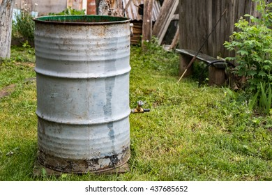 Metal barrel on grass