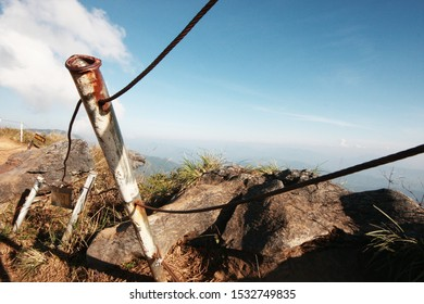"Metal barricade and Mountain barrier for safety in life from an accident on the cliff and Warning sign label in Thai characters Wrote that mean "" Danger Zone "" on hill in Thailand"