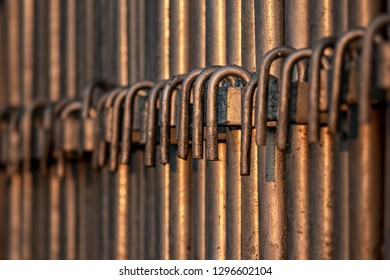 metal bars in a row at sunset