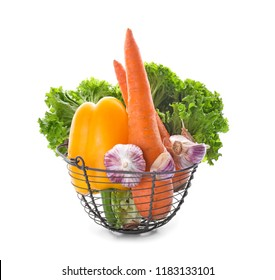 Metal basket with various fresh vegetables on white background
