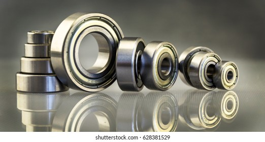 Metal bearing. Spare parts for machinery. Steel bearing with balls. Composition with bearings. Mechanisms, transport.