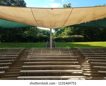 metal benches or seating with fabric covering overhead and cement steps