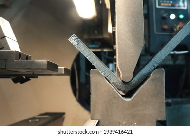 Metal bending. The process of metal bending on a CNC bending machine. Bending of metal using a v-shaped matrix and a punch.