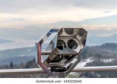 Metal binoculars on top of the viewing tower on Uetliberg in Zurich, Switzerland.