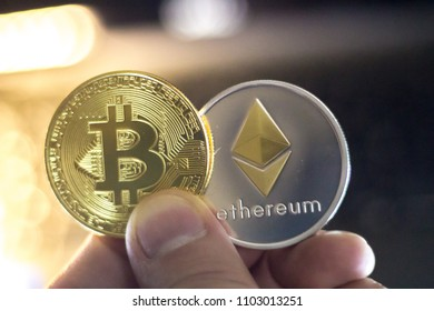 Metal Bitcoins and Ethereum coins. Bitcoin, Ethereum - modern virtual eletronic money