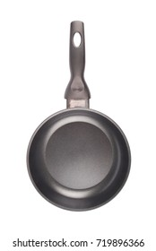 Metal black frying pan with a non-stick coating isolated on white background with soft shadow