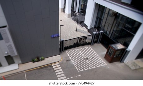 Metal black gate. Footage. Beautiful, modern wrought-iron gates, entrance to the courtyard. Black metal driveway entrance gates