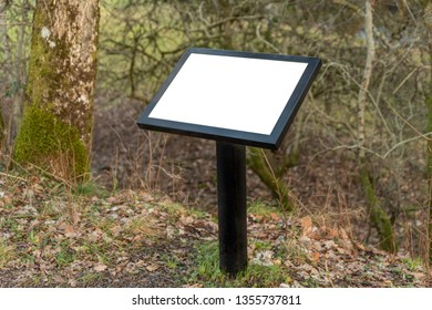 A metal blank notice board with copy space in a rural location.