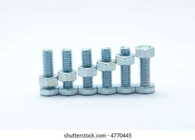 metal bolts and nuts aligned