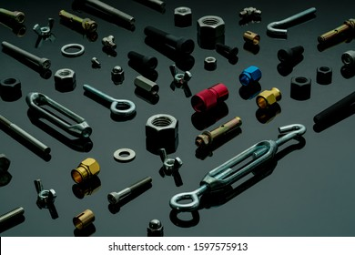 Metal bolts, nuts, and washers. Fasteners equipment. Hardware tools. Different types of nuts, bolts, and screws on table in workshop. Mechanic tools. Threaded fastener use in automotive engineering. - Shutterstock ID 1597575913