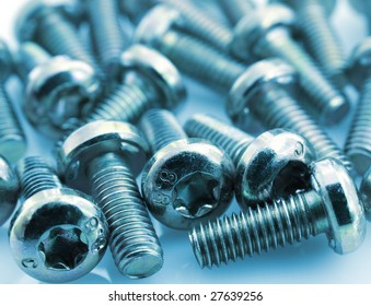 Metal bolts on white background