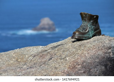 Metal boot sited near the Finisterre lighthouse. Location: Finisterre, Galicia, Spain.