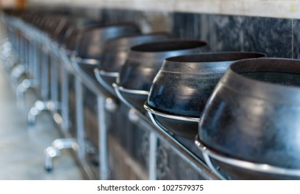 Metal bowls in the temple
