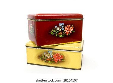 Metal boxes with flower decoration on a white background