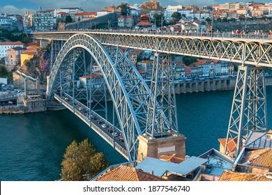 metal bridge Dom Luis over the Douro river in the ancient Portuguese city of Porto