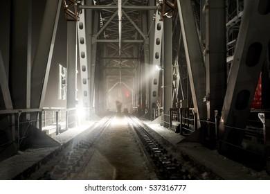 Metal bridge in the russian winter night.