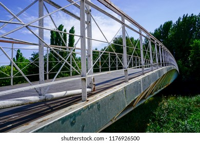 metal bridge of white color on the river carrion in the city of Palencia