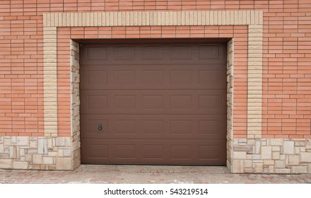 Metal brown gates of the private garage.