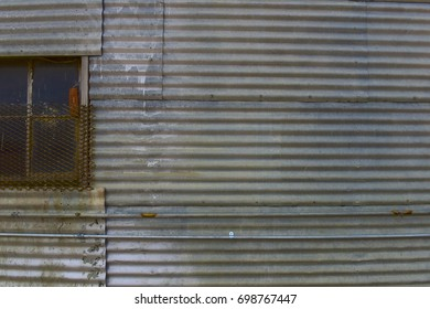 Metal building with siding and window