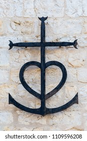 Metal Camargue cross from provencal Saintes Maries de la Mer symbolizing the three cardinal virtues: faith (cross), charity (heart) and hope (anchor)