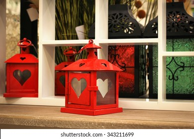 Metal candle holder lantern in the interior.