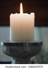 Metal candlestick retro silver style with lit candle