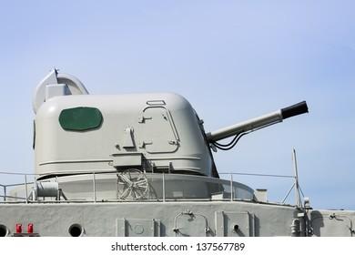 Metal canon on deck of a museum WW2 battleship