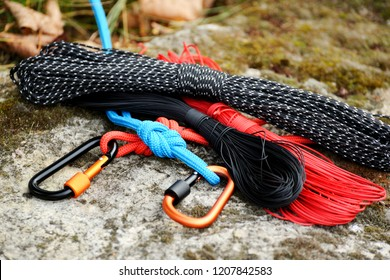 Metal carabine and rope for mountaineering. Photo of colored carabines and rope. Climbing concept
