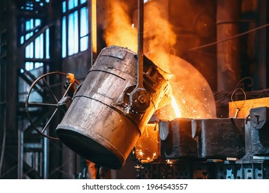 Metal casting process in foundry, liquid metal pouring from container to mold with clubs of steam and sparks, heavy metallurgy industry background