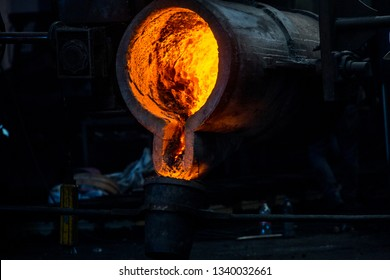 metal casting process with red high temperature fire in metal part factory