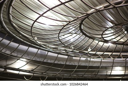 Metal ceiling in high-tech style with lighting. Metal construction with lighting.