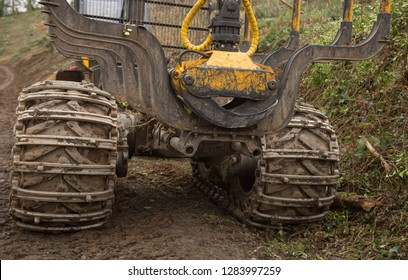 Metal Chains on the Tyres of a Logging Trailer and Grabber in Eggesgord Forest in Rural Devon, England, UK