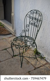 Metal chair in the outside patio place waiting to be used