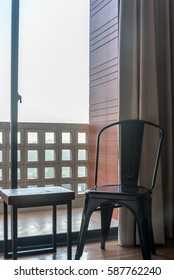 Metal chair with side table in modern Living room / home decoration & renovation conceptual
