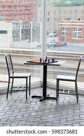 Metal chairs near a window