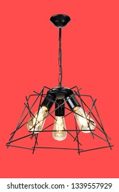 metal chandelier lamp on red background