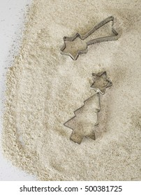 Metal Christmas Tree Cutters in Freshly Sifted Flour