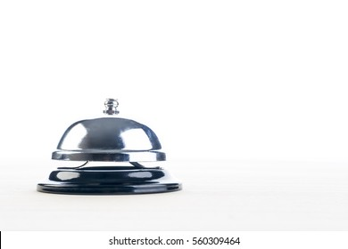 Metal chrome bell on the table.
